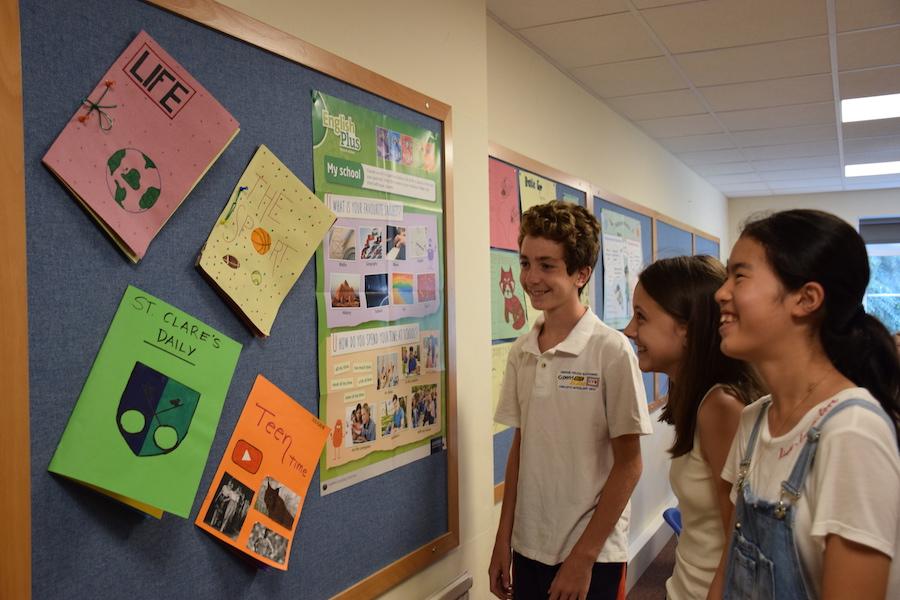 Summer junior students around notice board