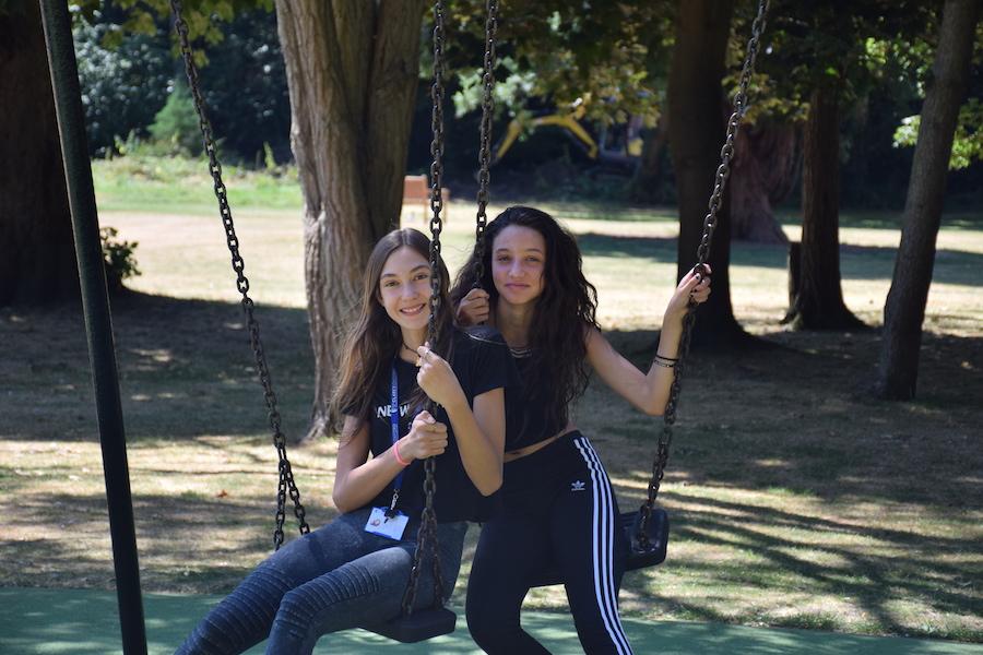 Summer junior students on swings
