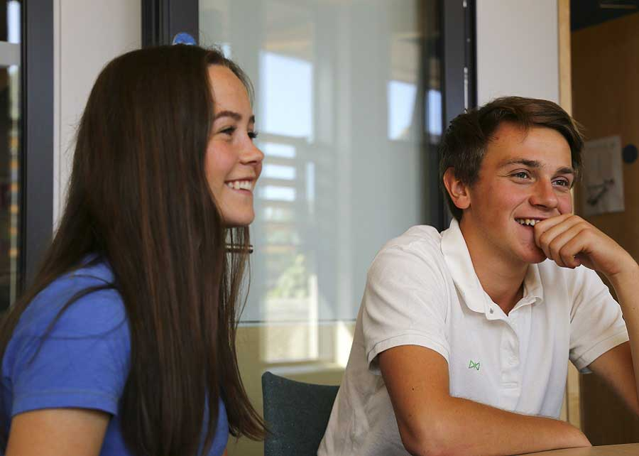 two smiling students in classroom