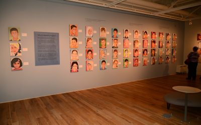 Students' portraits in art exhibition